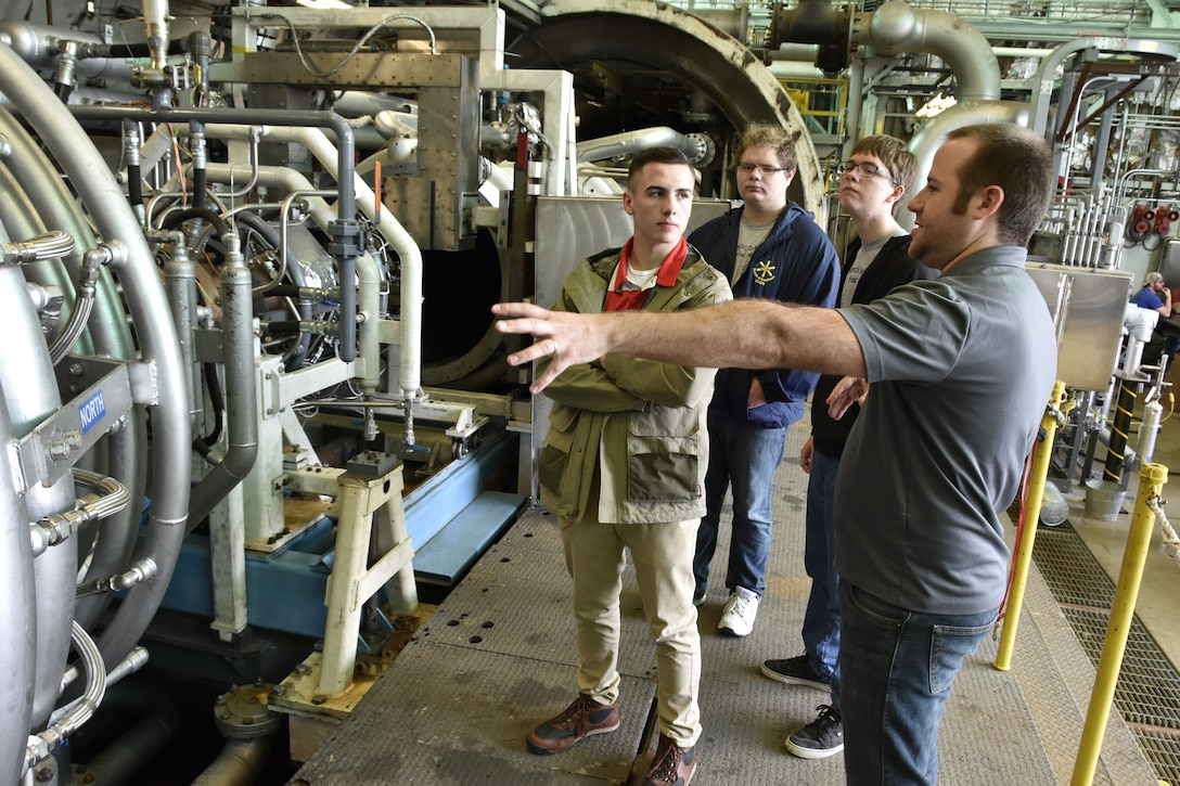 Arnold Air Force Base Aerospace Engineer Kevin Holst (right) describes the operation of the Aerodynamic and Propulsion Test Unit to Kaleb Smith (from left), Tim Barlow and Kendall Purdom. The local students were invited to participate in Engineer-for-a-Day on Feb. 21, 2018, as part of the Arnold AFB Engineers Week. (U.S. Air Force photo by Rick Goodfriend)