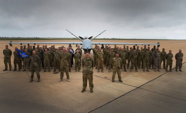 Lt. Col. Stephen Eide, 12th Special Operations Squadron commander, stands in formation with his squadron in front of an MQ-9 Reaper aircraft at Cannon Air Force Base, N.M., Sept. 7, 2018. (U.S. Air Force photo by Staff Sgt. Luke Kitterman)