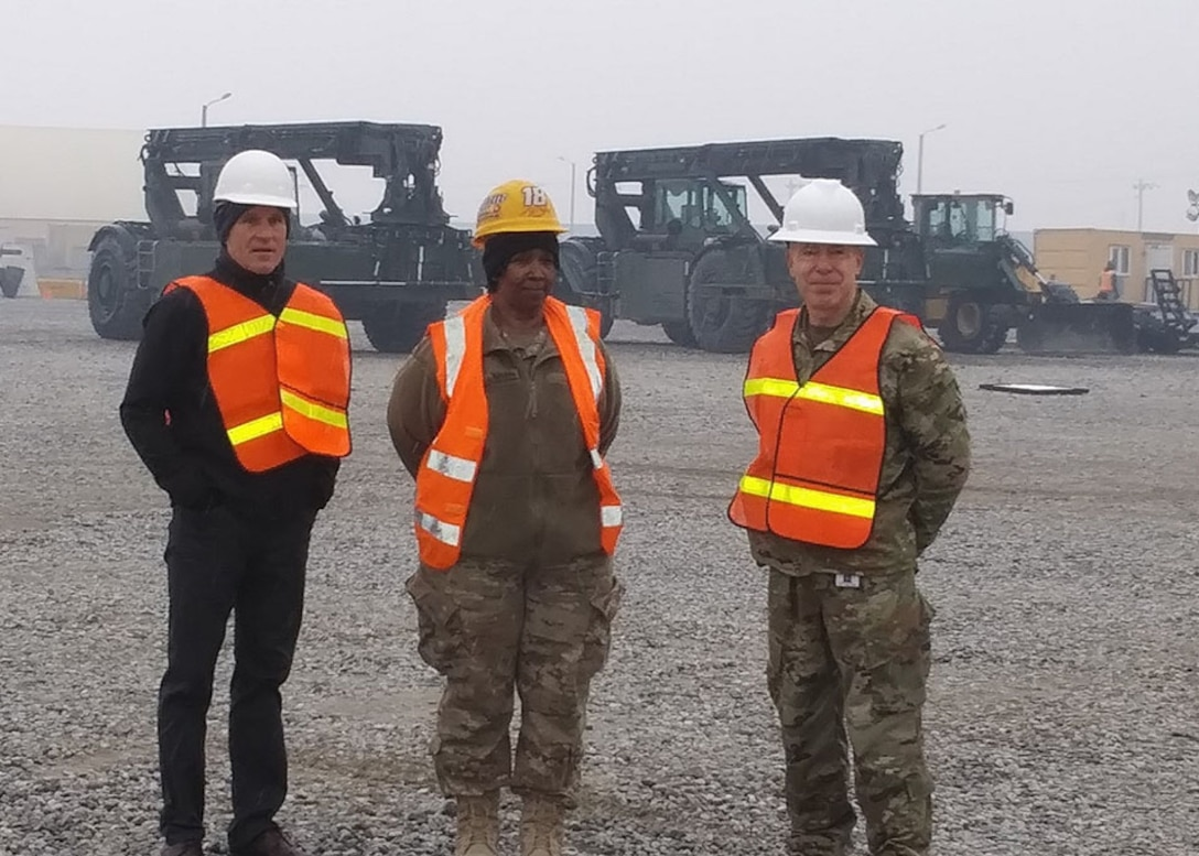 Robert Helgeson (left), U.S. Central Command's deputy director for logistics and engineering, listens as LaTanya Callahan (center), area manager, and Navy Cmdr. Max Becker, officer in charge of DLA Disposition Services in Afghanistan, explain yard operations.