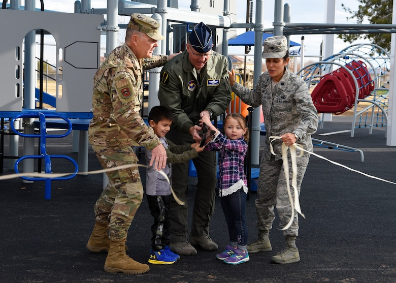Leadership from the 56th Fighter Wing participate in a ribbon cutting ceremony, officially opening a new playground at Fowler Park, Jan. 9, 2019, at Luke Air Force Base, Ariz.