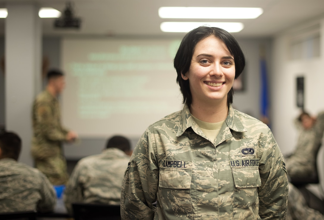 Airman 1st Class Elizabeth Campbell, 60th Aerial Port Squadron air transportation apprentice, poses for a photo Jan. 8, 2019, at Travis Air Force Base, Calif. Campbell was appointed the class leader position for First Term Airman Course which is designed to help transition Airmen from the technical training atmosphere to the operational Air Force. (U.S. Air Force photo by Airman 1st Class Jonathon Carnell)