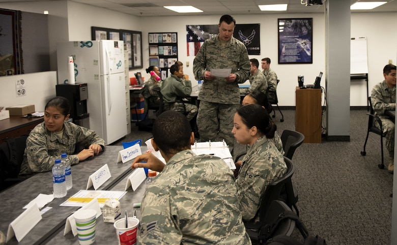 U.S. Air Force Tech. Sgt. Nathaniel Hyder, 821st Contingency Response Support Squadron equipment technician, instructs Airmen who are in the First Term Airman Course class Jan. 10, 2019, at Travis Air Force Base, Calif. Hyder is the FTAC team lead where he oversees Airmen who are transitioning from the technical training atmosphere to the operational Air Force. (U.S. Air Force photo by Airman 1st Class Jonathon Carnell)