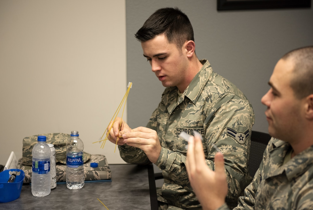 Airman 1st Class Dallas Ketcham, left, 60th Maintenance Squadron fuels systems apprentice, works with Airman Brandon Mc Entire, 60th MXS Precision Measurements and Equipment laboratory apprentice, during a competition with the First Term Airman Course class Jan. 10, 2019, at Travis Air Force Base, Calif. Airmen attend FTAC to help transition from the technical training atmosphere to the operational Air Force. (U.S. Air Force photo by Airman 1st Class Jonathon Carnell)