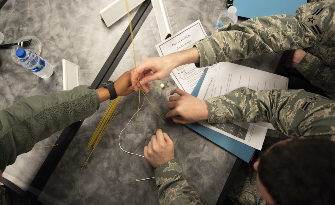 Airmen in the First Term Airman Course class work together during a competition Jan. 10, 2018, at Travis Air Force Base, Calif. Airmen attend FTAC to help transition from the technical training atmosphere to the operational Air Force. (U.S. Air Force photo by Airman 1st Class Jonathon Carnell)