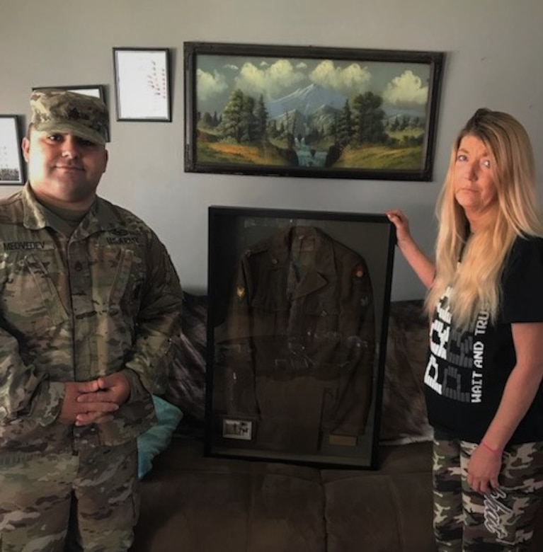 soldier in multicam Army uniform and Lori Ayers-Brown standing together