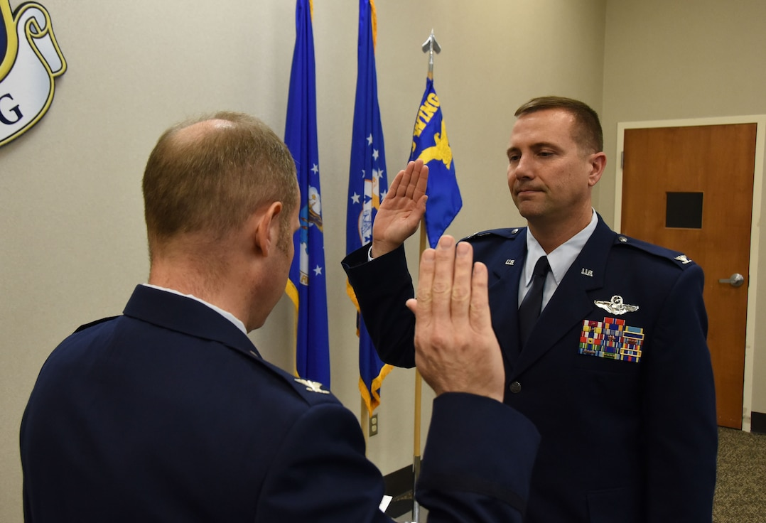 Air Force Lt. Col. Todd Wiles, commander of the 118th Operations Group, Tennessee Air National Guard, takes the oath of office from Col. Keith Allbritten, commander of the 118th Wing, on Jan. 2, 2019 at Berry Field Air National Guard Base, Nashville, Tennessee.