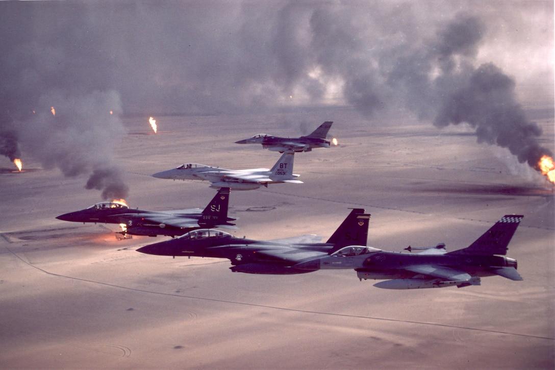 Three airborne fighter jets