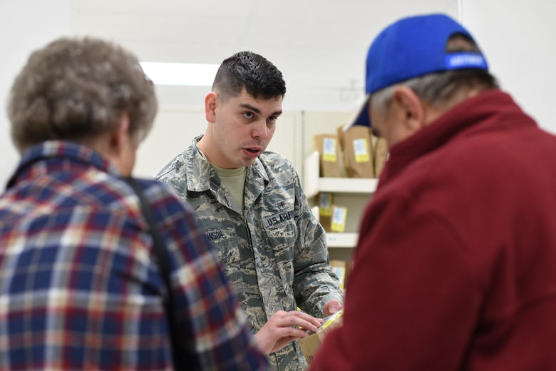 U.S. Air Force Airman 1st Class Tyler Johnson, 377th Medical Support Squadron pharmacy technician, assists patients at the Base Exchange Pharmacy at Kirtland Air Force Base, N.M., Jan. 8, 2019. In 2018, the 377th MDSS Pharmacy Flight filled over 215,000 prescriptions. (U.S. Air Force photo by Senior Airman Eli Chevalier)