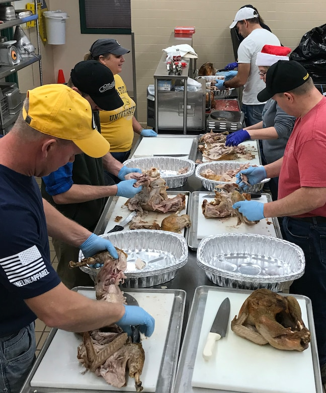 GREAT FALLS, Mont. -- Current and retired members of the 120th Airlift Wing, Montana Air National Guard, carve turkeys Dec. 24, 2018 at the MTANG dining facility here.
