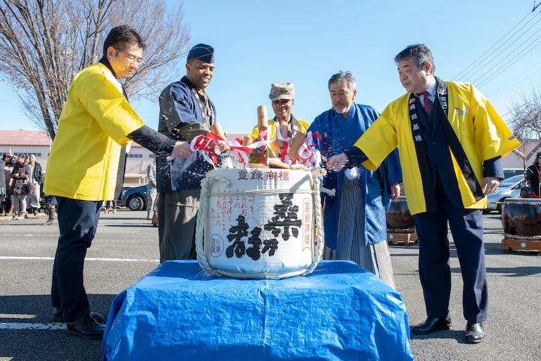 Col. Otis C. Jones, 374th Airlift Wing commander and members of the Japanese Welfare Association (JWA) perform a Kagami-biraki, or sake barrel opening ceremony, at Japanese Culture Day at Yokota Air Base, Japan, Jan. 11, 2019.