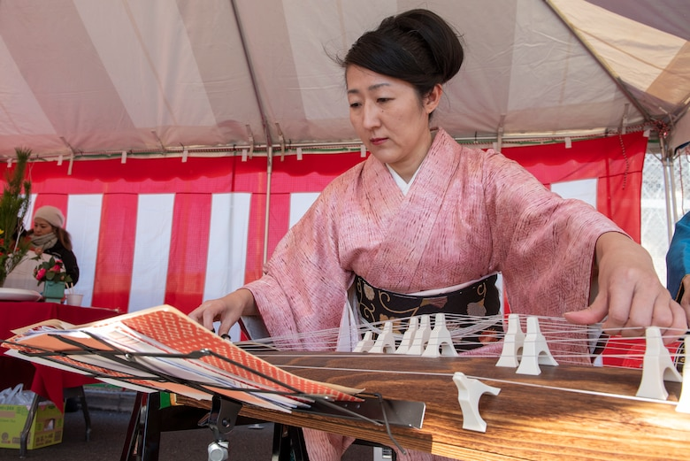 A musician plays the koto, a traditional Japanese stringed instrument at the annual Japanese Culture Day at Yokota Air Base, Japan, Jan. 11, 2019.