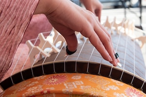 Fingers strum the strings of a koto, a traditional Japanese instrument at the annual Japanese Culture Day at Yokota Air Base, Japan, Jan. 11, 2019.