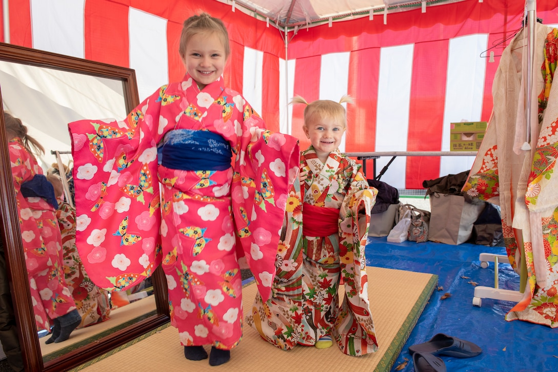 Children smile for the camera while wearing kimonos at Japanese Culture Day at Yokota Air Base, Japan, Jan. 11, 2019.