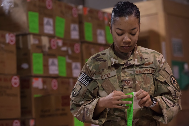 Staff Sgt. Jasmine Gates, 379th Expeditionary Aeromedical Evacuation Squadron aeromedical evacuation technician, labels boxes used to transport blood in the Blood Transshipment Center (BTC) Jan. 9, 2019, at Al Udeid Air Base Qatar. Gates volunteered time to assist Airmen at the BTC in preparing blood products for transport. The BTC is comprised of a four-person team that orchestrates the flow of blood and platelet products to 72 forward operating locations and eight mobile field surgical teams throughout U.S. Central Command's area of responsibility. (U.S. Air Force by Tech. Sgt. Christopher Hubenthal)