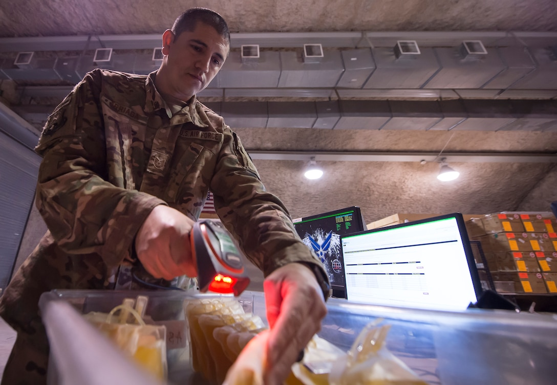 Tech. Sgt. Federico Arriaga, 379th Expeditionary Medical Group Blood Transshipment Center (BTC) logistics craftsman, scans barcodes on blood containers in the BTC Jan. 9, 2019, at Al Udeid Air Base, Qatar. The BTC is comprised of a four-person team that orchestrates the flow of blood and platelet products to 72 forward operating locations and eight mobile field surgical teams throughout U.S. Central Command's area of responsibility. (U.S. Air Force by Tech. Sgt. Christopher Hubenthal)