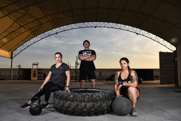 (From left to right) U.S. Air Force Master Sgt. Megan Bender, 727th Expeditionary Air Control Squadron weapons director; Staff Sgt. Nathaniel Roark, 380th Expeditionary Civil Engineer Squadron firefighter; and Staff Sgt. Janet Soto, 380th Expeditionary Logistics Readiness Squadron container control officer, pose for a photo at Al Dhafra Air Base United Arab Emirates, Jan. 8, 2019. The Airmen competed against 143 others from bases such as Bagram Airfield, Afghanistan, and Ali Al Salem Air Base, Kuwait, in the Strongest in the AOR competition. (U.S. Air Force photo by Senior Airman Mya M. Crosby)