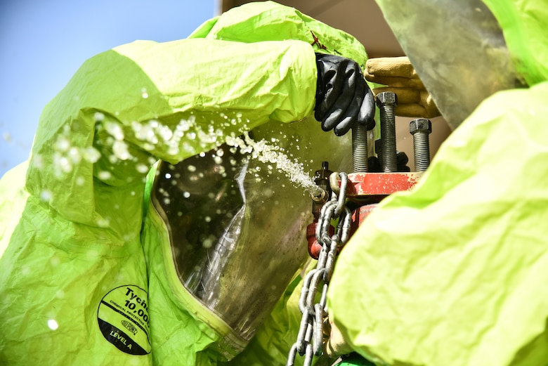 U.S. Airmen assigned to the 380th Expeditionary Civil Engineer Squadron Emergency Management flight cap a leaking gate valve of a simulated pressurized chlorine cylinder during a hazardous materials exercise at Al Dhafra Air Base, United Arab Emirates, Jan. 4, 2019. The exercise was designed to be a Department of Defense certification for three Airmen in the fire department and an annual refresher training for the EM flight. The Airmen were instructed to contain leaks on a pressurized chlorine cylinder, a one-ton cryo-tank, and a rail car, all after donning a Level-A suit. (U.S. Air Force photo by Senior Airman Mya M. Crosby)