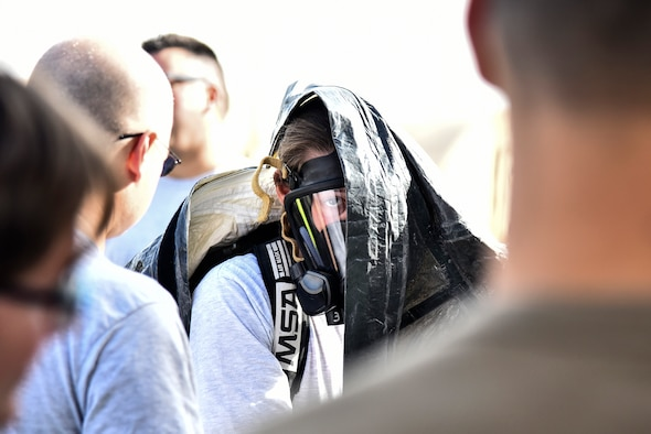 U.S. Air Force Senior Airmen Sarah Howell, 380th Expeditionary Civil Engineer Squadron emergency management journeyman, dons a Level-A suit during a hazardous materials exercise at Al Dhafra Air Base, United Arab Emirates, Jan. 4, 2019. The 380th ECES Fire Department and Emergency Management flights conducted a joint-agency hazardous material exercise for training purposes. (U.S. Air Force photo by Senior Airman Mya M. Crosby)