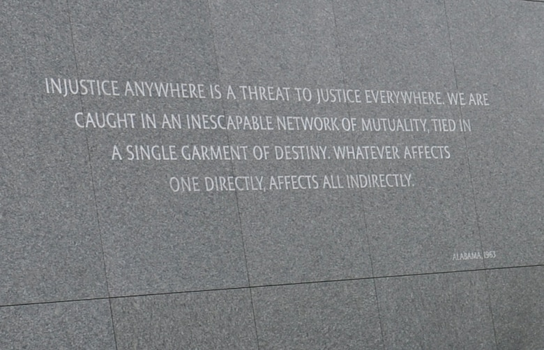 A wall inscribed with a quote from Dr. Martin Luther King stands in West Potomac Park next to the National Mall, Washington D.C. The quote is from a letter King wrote in a Birmingham, Alabama, jail in April 1968. (U.S. Air Force photo by L. Cunningham)