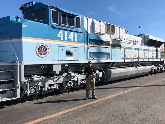 Master Sgt. Shana Cobbs in front of the George Bush 4141 Locomotive Dec. 3, 2018, in Spring, Texas Cobbs provided security for the locomotive during the Bush funeral detail, securing the areas prior to arrival at each location.