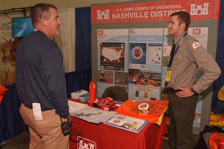 Old Hickory Lake Park Ranger Will Gore assists a visitor Jan. 10, 2019 during the Nashville Boat Show at Music City Center in Nashville, Tenn. (USACE photo by Lee Roberts)