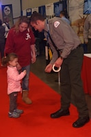 Old Hickory Lake Park Ranger Will Gore gives a junior ranger sticker to a young girl Jan. 10, 2019 during the Nashville Boat Show at Music City Center in Nashville, Tenn. (USACE photo by Lee Roberts)