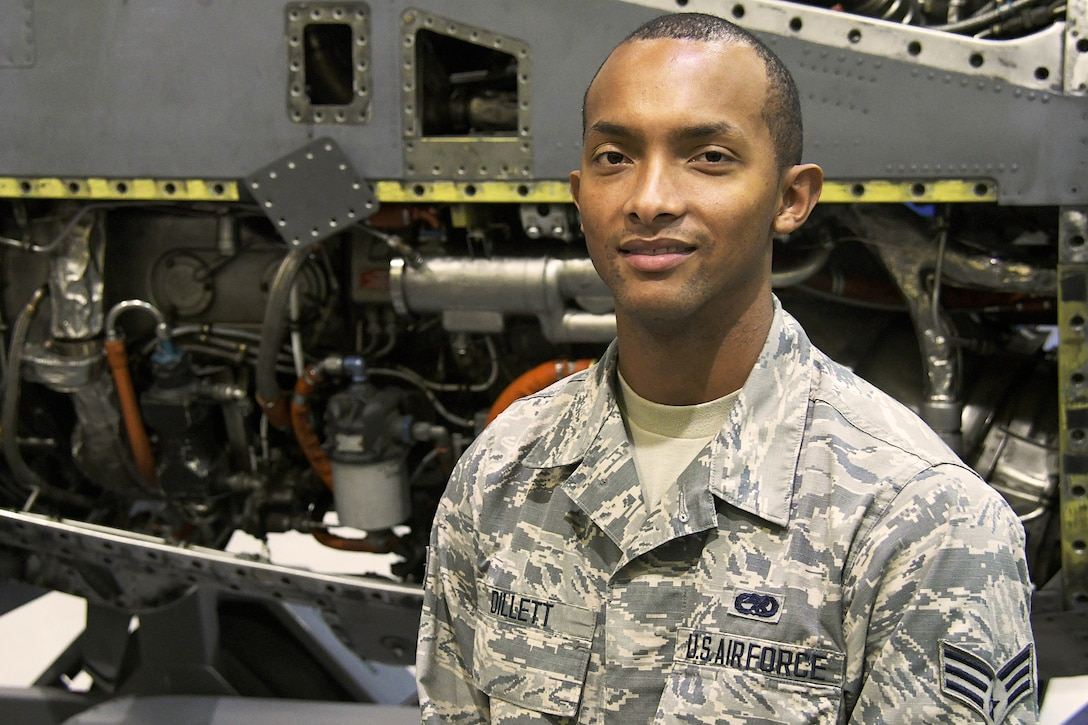 Senior Airman Damian Dillett, a 94th Aircraft Maintenance Squadron aircraft engine technician, poses for a photo in a maintenance hangar at Dobbins Air Reserve Base, Ga. Dec. 9, 2018. Dillett recently graduated from the Cobb County Police Academy in Georgia. (U.S. Air Force photo/Staff Sgt. Andrew Park)