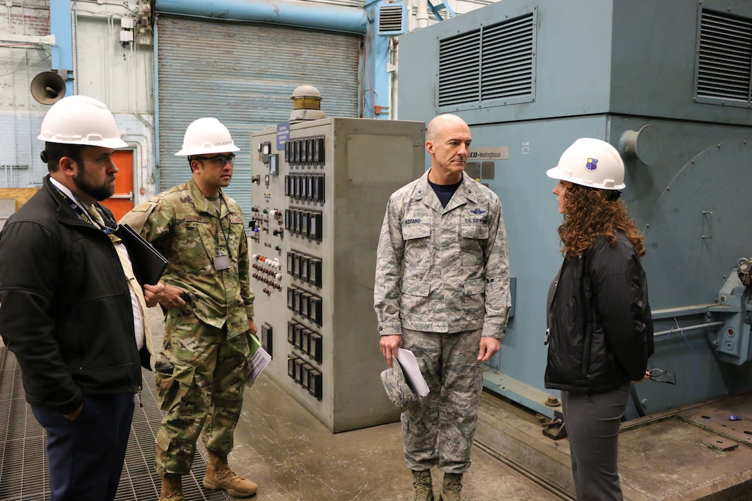 Brig. Gen. Christopher Azzano, commander of the Air Force Test Center, second from right, receives an update on upcoming Service Life Extension Program projects at AEDC from TSS Capital Improvements Lead Engineer and SLEP Manager Kathleen Bajar, right. Also pictured are TSS Capital Improvements Technical Advisor Josh Meeks, left, AEDC Test Systems Sustainment Chief Col. John Tran. Azzano and other AFTC leadership visited Arnold Air Force Base in mid-November to take part in the 2018 AFTC Strategic Offsite, Azzano's first offsite since assuming the role of AFTC commander in August. (U.S. Air Force photo by Brad Hicks) (This image was altered by obscuring badges for security purposes)