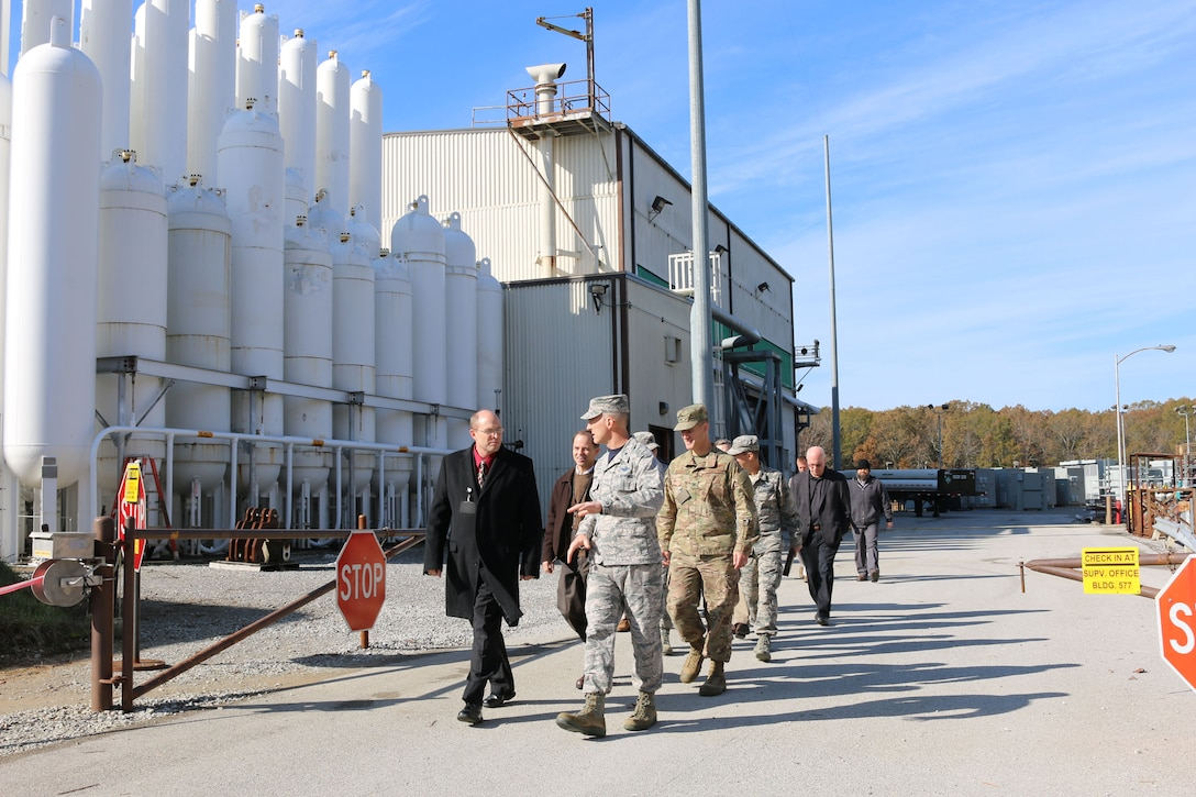 Brig. Gen. Christopher Azzano, commander of the Air Force Test Center, right, speaks with Lance Baxter, director of the AEDC Hypersonic Systems Combined Test Force, during a Nov. 16 tour of the Aerodynamic & Propulsion Test Unit. Azzano and other AFTC leadership visited Arnold Air Force Base in mid-November to take part in the 2018 AFTC Strategic Offsite, Azzano's first offsite since assuming the role of AFTC commander in August. (U.S. Air Force photo by Brad Hicks) (This image was altered by obscuring badges for security purposes)