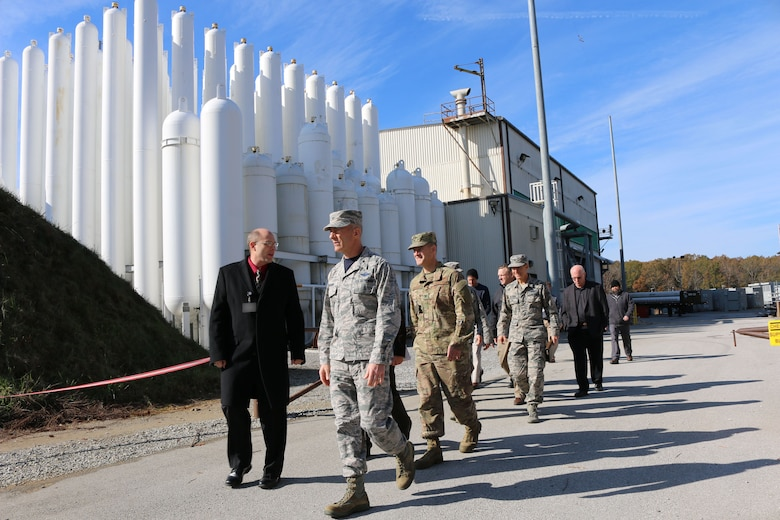 Brig. Gen. Christopher Azzano, commander of the Air Force Test Center, right front, tours the Aerodynamic & Propulsion Test Unit at Arnold Air Force Base on Nov. 16. The facility tour was led by AEDC Hypersonic Systems Combined Test Force Director Lance Baxter, who is on Azzano's right. Azzano and other AFTC leadership visited Arnold Air Force Base in mid-November to take part in the 2018 AFTC Strategic Offsite, Azzano's first offsite since assuming the role of AFTC commander in August. (U.S. Air Force photo by Brad Hicks) (This image was altered by obscuring badges for security purposes)