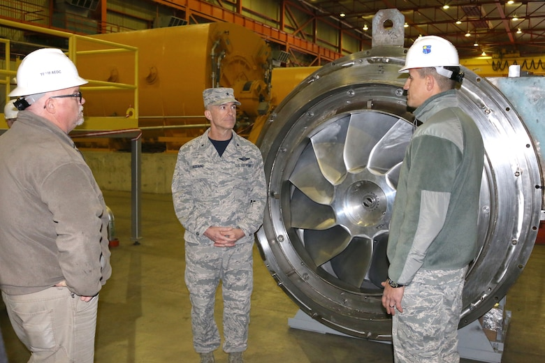 Lt. Col. David Garay, director of the Aeropropulsion Combined Test Force at Arnold Air Force Base, right, discusses some of the equipment found within the Aeropropulsion Systems Test Facility with Brig. Gen. Christopher Azzano, commander of the Air Force Test Center, center. Pictured at left is ASTF Asset Manager Jimmy Steele. Azzano and other AFTC leadership visited Arnold Air Force Base in mid-November to take part in the 2018 AFTC Strategic Offsite, Azzano's first offsite since assuming the role of AFTC commander in August. (U.S. Air Force photo by Brad Hicks)