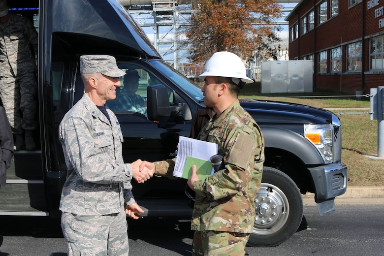 Brig. Gen. Christopher Azzano, commander of the Air Force Test Center, left, is greeted by AEDC Test Systems Sustainment Chief Col. John Tran outside of the Engine Test Facility at Arnold Air Force Base. Azzano and other AFTC leadership visited Arnold Air Force Base in mid-November to take part in the 2018 AFTC Strategic Offsite, Azzano's first offsite since assuming the role of AFTC commander in August. (U.S. Air Force photo by Brad Hicks) (This image was altered by obscuring badges for security purposes)