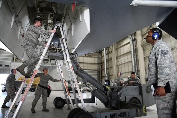 Weapon loaders from the 28th Munitions Squadron, the 34th Aircraft Maintenance Unit and the 37th Aircraft Maintenance Unit compete in an annual weapons loading competition at Ellsworth Air Force Base, S.D., Jan. 7, 2019. Each team was given 40 minutes to load two inert GBU-38 Joint Direct Attack Munitions and one inert AGM-158 Joint Air-to-Surface Standoff Missile onto a simulated B-1 bomber. (U.S. Air Force photo by Airman 1st Class Christina Bennett)