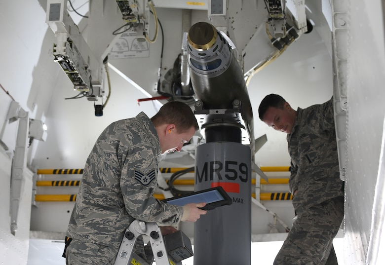 Staff Sgt. Cordel Shields, a 34th Aircraft Maintenance Unit load crew member, goes over his checklist after loading an inert GBU-38 Joint Direct Attack Munition onto a simulated B-1 bomber at the annual weapons load competition at Ellsworth Air Force Base, S.D., Jan. 7, 2019. During the competition, load crew teams were given 40 minutes to install two inert GBU-38 JDAMs and one inert AGM-158 Joint Air-to-Surface Standoff Missile onto a simulated B-1 bomber. (U.S. Air Force photo by Airman 1st Class Christina Bennett)