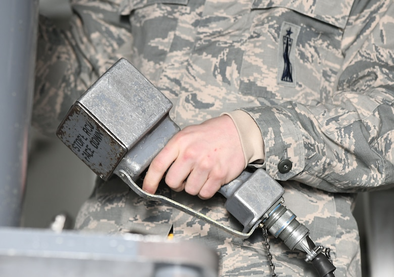 Staff Sgt. Cordel Shields, a 34th Aircraft Maintenance Unit load crew member, prepares to load a GBU-38 Joint Direct Attack Munition onto a simulated B-1 bomber at the annual weapons load competition at Ellsworth Air Force Base, S.D., Jan. 7, 2019. Load crew members are responsible for safely loading and unloading munitions, testing suspension, launch and release systems. (U.S. Air Force photo by Airman 1st Class Christina Bennett)