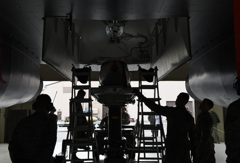 Load Crew Members assigned to the 34th Aircraft Maintenance Unit prepare to load an inert AGM-158 Joint Air-to-Surface Standoff Missile into a simulated B-1 Bomber at the annual weapons loading competition at Ellsworth Air Force Base, S.D., Jan. 7, 2019. The JASSM weighs 2,250 pounds and has to be lifted approximately 17 feet in the air to be inserted into the bomb bay of the simulated B-1 bomber. (U.S. Air Force photo by Airman 1st Class Christina Bennett)
