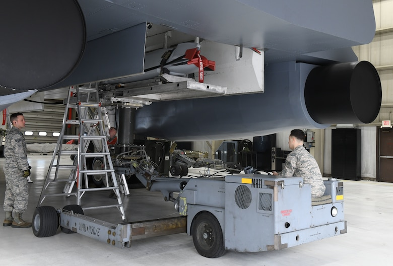 Load crew members from the 34th Aircraft Maintenance Unit use a munition truck or 'jammer', to load an inert AGM-158 Joint Air-to-Surface Standoff Missile into a simulated B-1 Bomber at the annual weapons load competition at Ellsworth Air Force Base, S.D., Jan.7, 2019. Squadron leadership selected weapons loaders to represent each unit as the best load crew of 2018. (U.S. Air Force photo by Airman 1st Class Christina Bennett)
