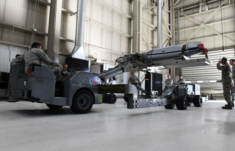 Load crew members from the 28th Munitions Squadron use a munitions lift truck or 'jammer', to load an inert AGM-158 Joint Air-to-Surface Standoff Missile into a simulated B-1 bomber at the annual weapons load competition at Ellsworth Air Force Base, S.D., Jan. 7, 2019. Each team was required to complete the loading process within 40 minutes and were also graded on proficiency, technique and safety. (U.S. Air Force photo by Airman 1st Class Christina Bennett)
