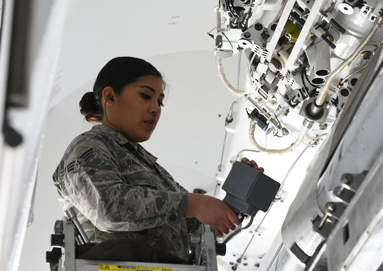 Senior Airman Andrea Walls, a 28th Munitions Squadron load crew member, loads an inert AGM-158 Joint Air-to-Surface Standoff Missile onto a simulated B-1 bomber at the annual weapons load competition at Ellsworth Air Force Base, S.D., Jan. 7, 2019. The JASSM weighs 2,250 pounds and must be lifted approximately 17 feet in the air to be inserted into the bomb bay of the simulated B-1. (U.S. Air Force photo by Airman 1st Class Christina Bennett)