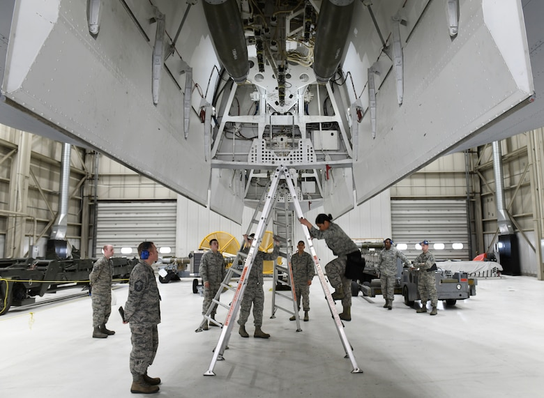 The load crew team from the 28th Munitions Squadron inspect their work after loading two inert GBU-38 Joint Direct Attack Munitions and one inert AGM-158 Joint Air-to-Surface Standoff Missile onto a simulated B-1 bomber during the annual weapons load competition at Ellsworth Air Force Base, S.D., Jan. 7, 2019. The winning team of the annual competition is announced at the Maintenance Professional of the Year awards banquet. (U.S. Air Force photo by Airman 1st Class Christina Bennett)