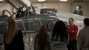 A Vertex Aerospace worker explains T-38C Talon maintenance to visitors from the Palmer Home for Children in the BLAZE hangar, Jan. 4, 2019, on Columbus Air Force Base, Mississippi. The visitors explored many aspects of Columbus AFB including static displays, time in flight simulators and much more. (U.S. Air Force photo by Airman 1st Class Holcomb)