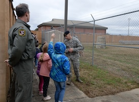 Tech. Sgt. Bruce Weir, 14th Security Forces Squadron military working dog trainer, answers questions during a MWD demonstration, Jan. 4, 2019, at the MWD kennel on Columbus Air Force Base, Mississippi. The visitors explored many aspects of Columbus AFB including static displays, time in flight simulators and much more. (U.S. Air Force photo by Airman Hannah Bean)