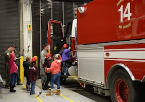Visitors from the Palmer Home for Children explore a fire truck Jan. 4, 2019, at the 14th Civil Engineer Squadron Fire Department on Columbus Air Force Base, Mississippi. Approximately 40 children and volunteers from the Palmer Home for Children in Columbus, Mississippi, visited the base to learn about its mission. (U.S. Air Force photo by Airman Hannah Bean)