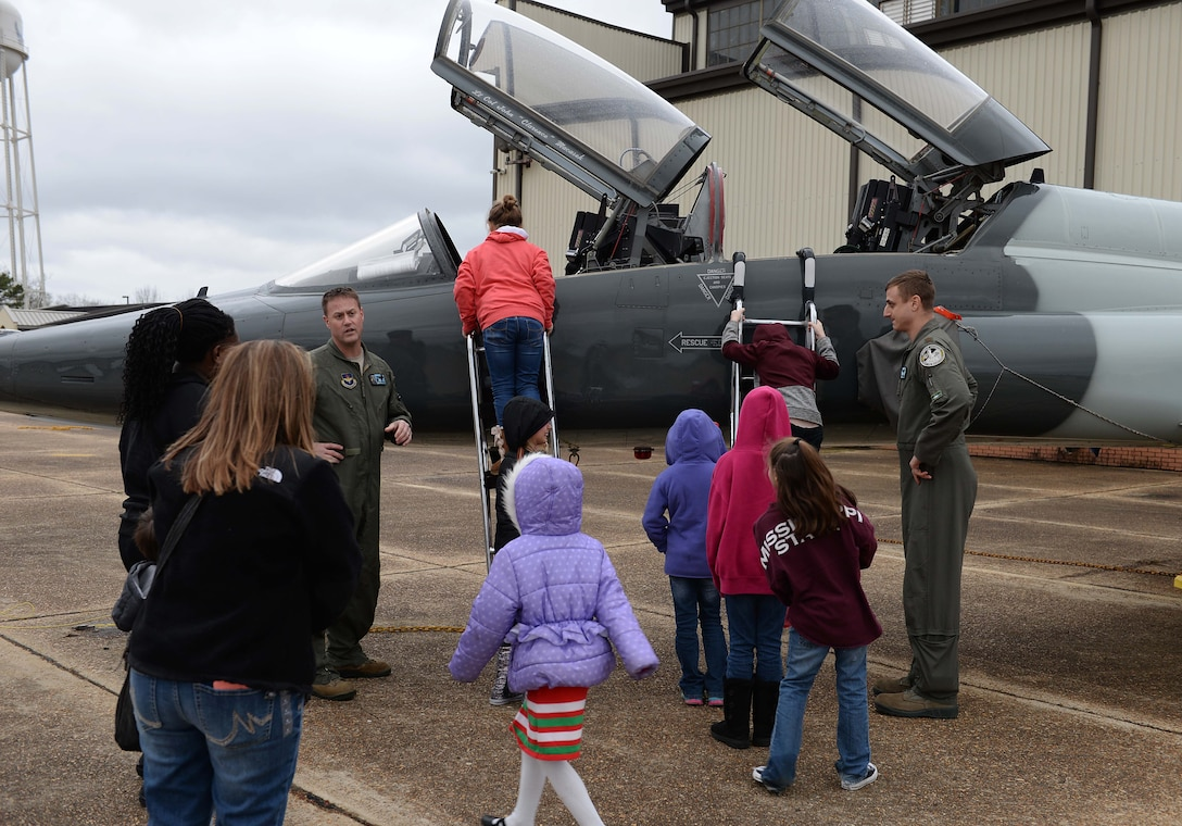 Pilots from 49th Fighter Training Squadron show the T-38C Talon to visitors from the Palmer Home for Children Jan. 4, 2019, on the flight line at Columbus Air Force Base, Mississippi. The visit was hosted by the 49th Fighter Training Squadron. (U.S. Air Force photo by Airman Hannah Bean)