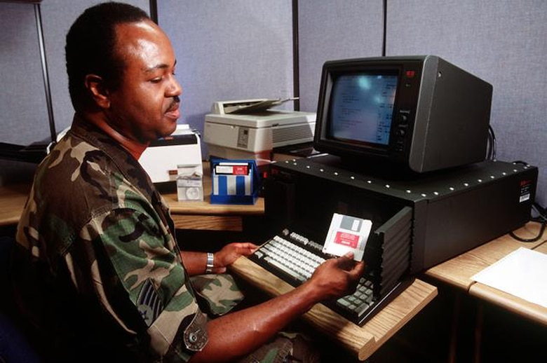 Master Sgt. Gregory E. Settles uses a UKY-83 desktop computer in the combat communications center to convey information to the United States Central Command Area of Operation from Langley AFB, Virginia, 8 Jan 1992. 