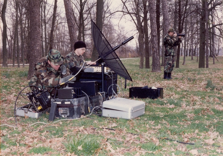 Two AFC4A Hammer ACE team members setting up the LSSC-300 terminal and portable satellite antenna during a training exercise at Scott AFB during the 1990s. 