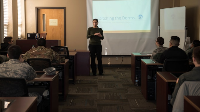 "Chryzelle Cabrillas-Harris, Airman and Family Readiness Center community readiness consultant, teaches the workshop, ""Ditching the Dorms,"" Jan. 11, 2019, at Offutt Air Force Base, Nebraska. The course helps service members moving out of the base dormitories. (U.S. Air Force photo by Zachary Hada)"