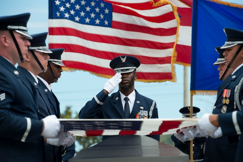 Airmen assigned to the U.S. Air Force Honor Guard fold an American flag