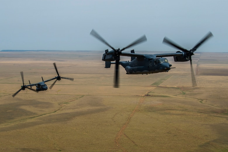 Two CV-22 Osprey aircraft fly close together