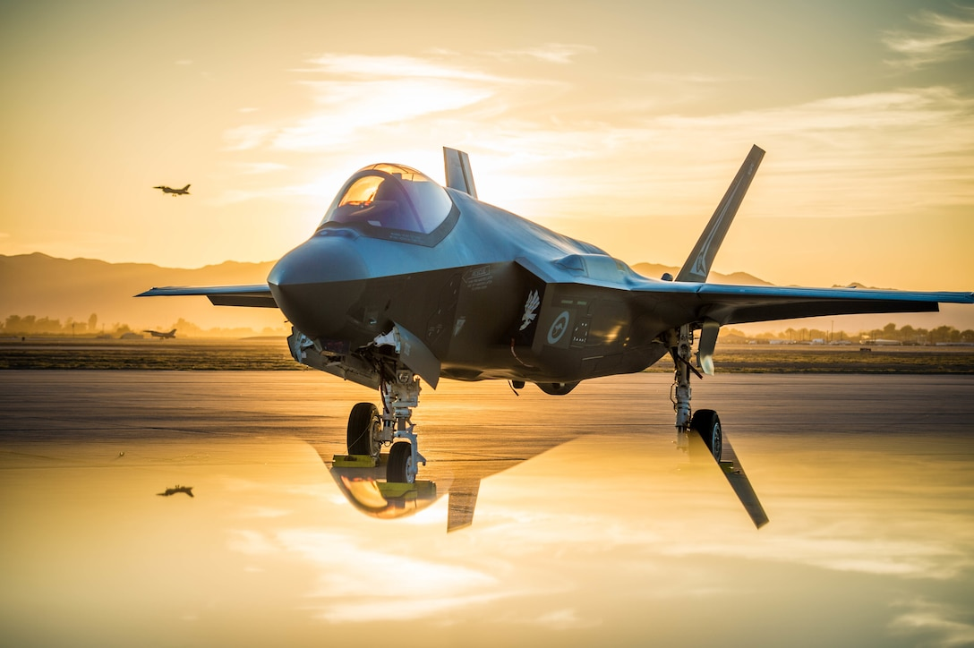 The sun sets behind an Australian F-35A Lighting II